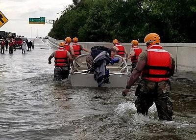 Texas National Guardsman drag a boat to shore - photo credit: Texas National Guard