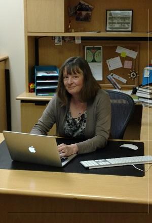 Anne-Marie Deitering sitting at her desk