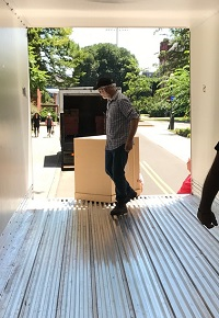 Bryan Feyerherm moving a box off a truck.