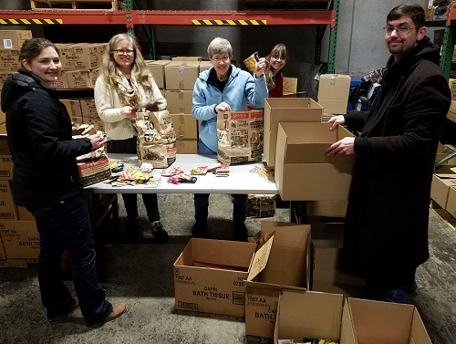 Library and Extended Campus employees working at the food packing plant.